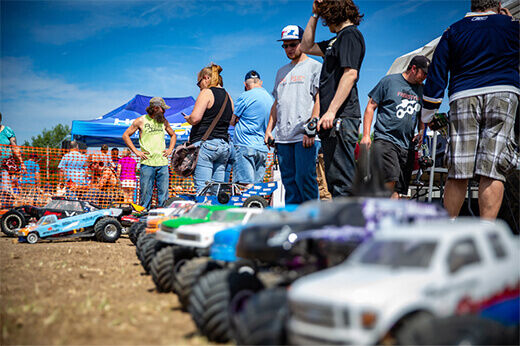 RC surface vehicles lined up in the dirt at RC Fest 2019.