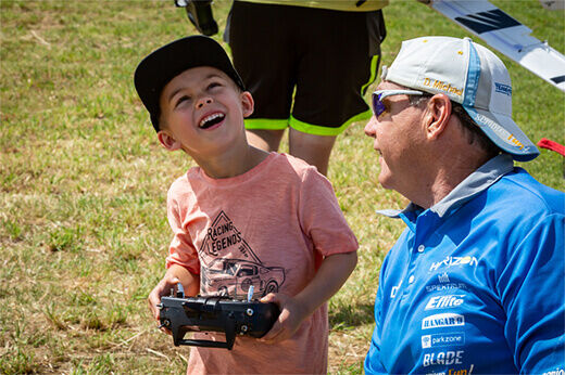 A Team Horizon member encourages a young pilot at RC Fest 2019.