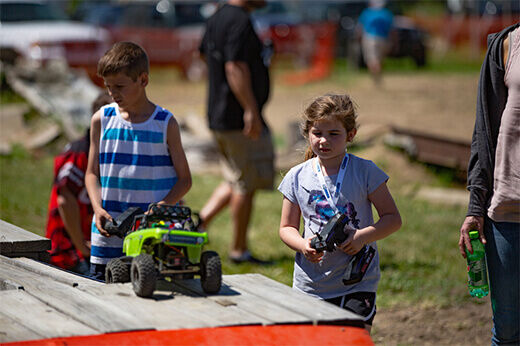 A young girl and drives her crawler at RC Fest 2019.