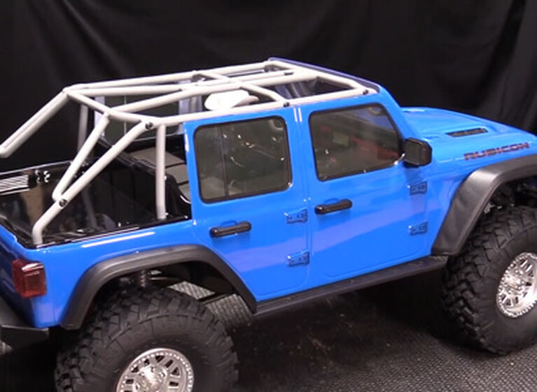 Picture of a modified Axial SCX10 III on workbench