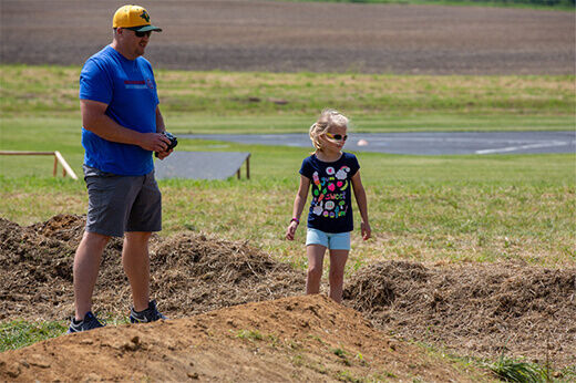 A father and daughter crawling through an RC course at at RC Fest 2019.