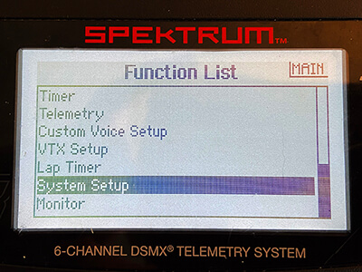 Screenshot: With your transmitter powered on, enter your Function List and scroll down/select the System Setup option.